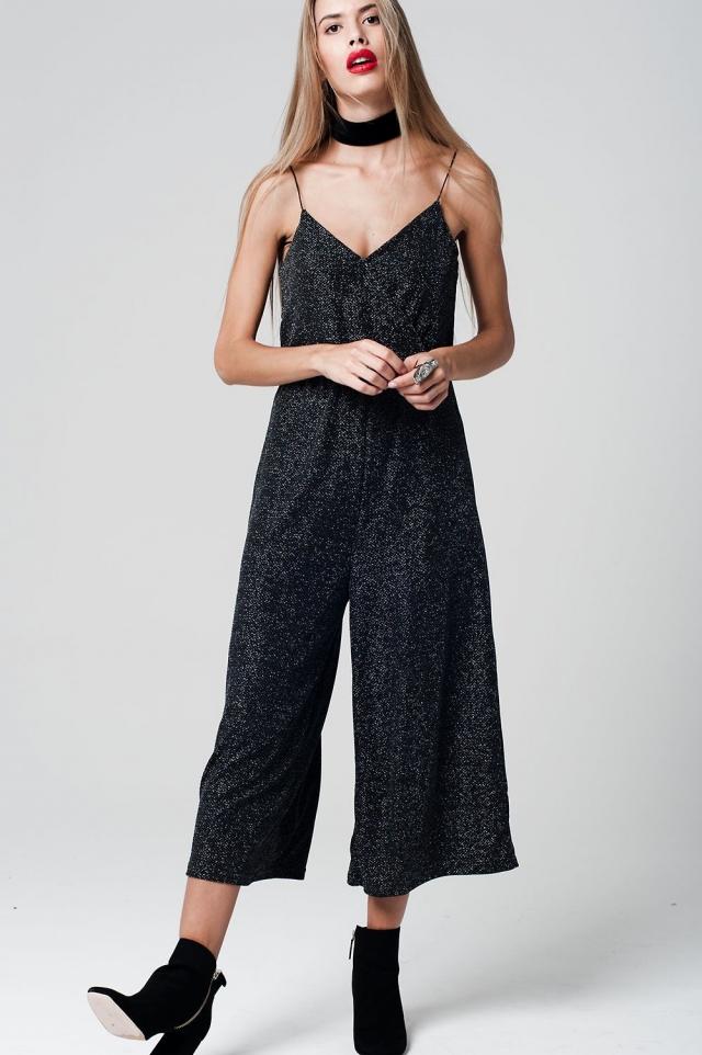 Tuta lunga in nero tessuto metallico con spalline e gonna pantalone