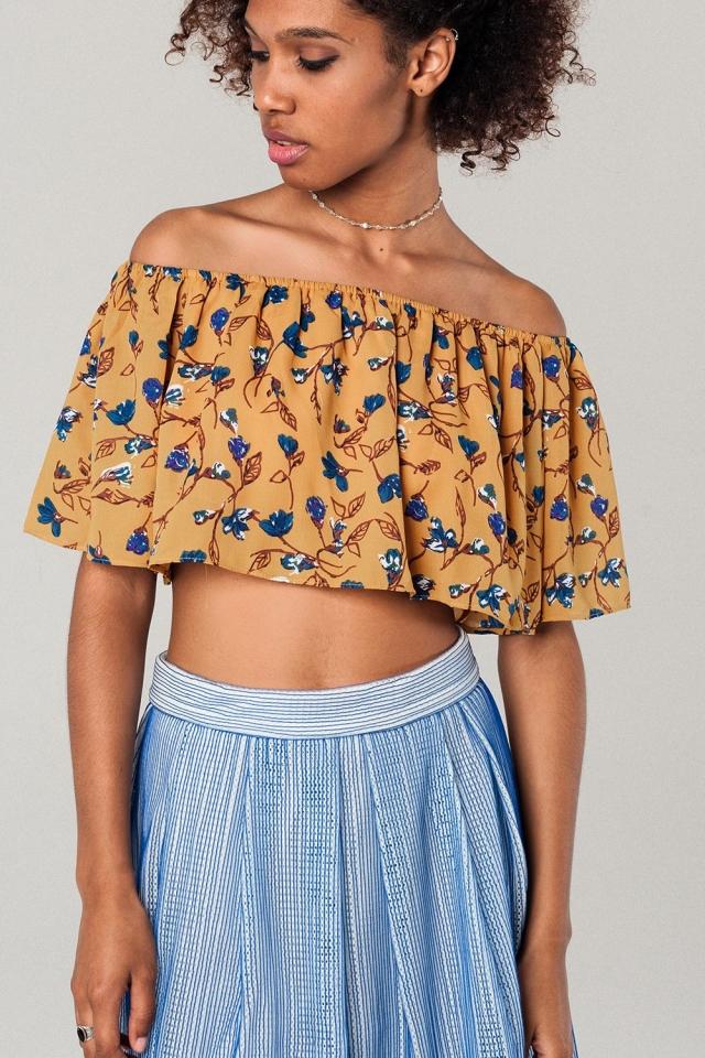 Top corto con stampa floreale e spalle scoperte di colore senape