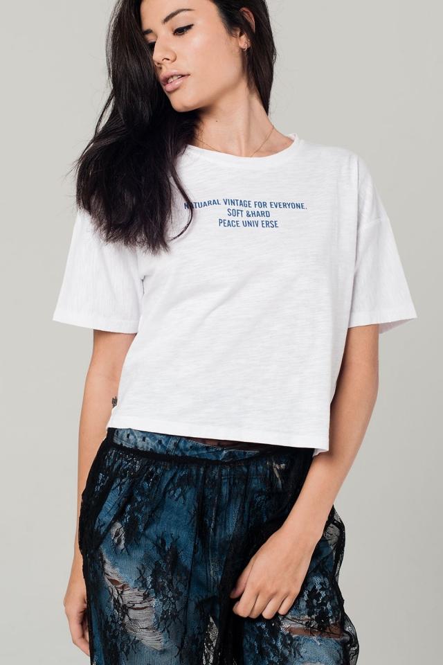 T-shirt bianco con dettagli di testo