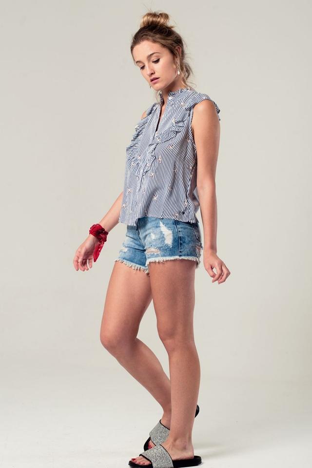 Camicia a righe blu marino con volant e stampa di uccelli