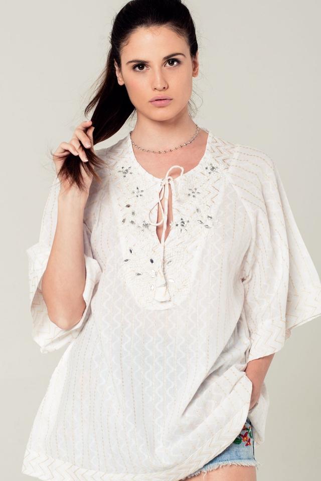 Mini abito bianco con dettagli ricamati