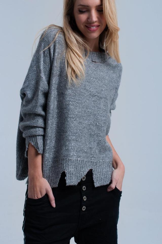 Maglione grigio con strappi