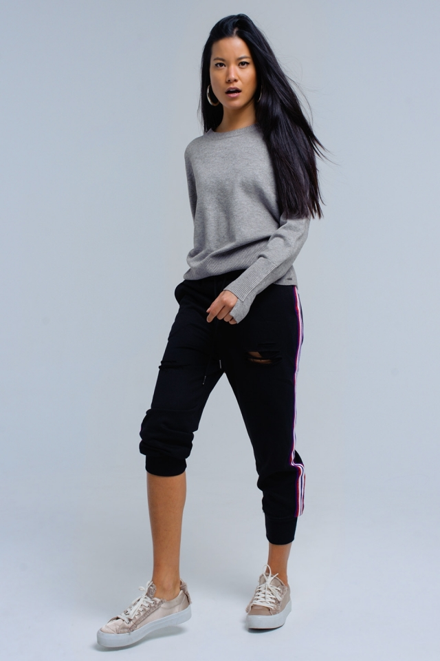 Pantaloni neri con strappi