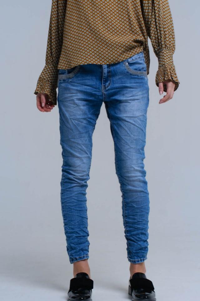 Jeans skinny blu con dettagli in paillettes
