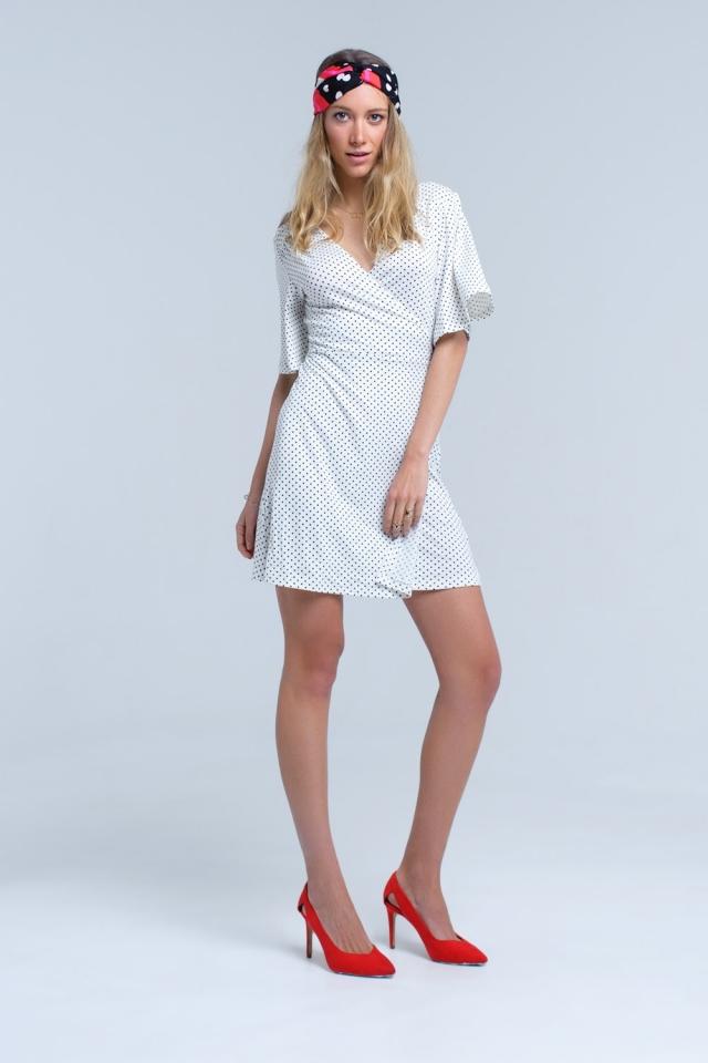 Vestito midi a pois bianco frontale avvolgente