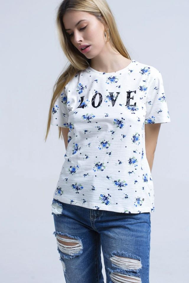 T-shirt con stampa floreale e logo