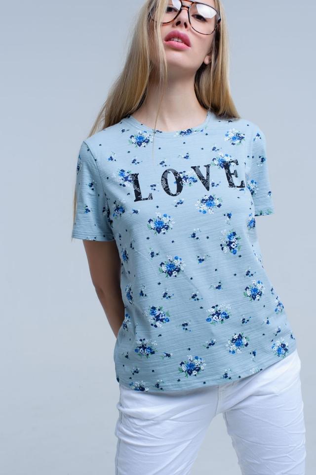 T-shirt blu con stampa floreale e logo