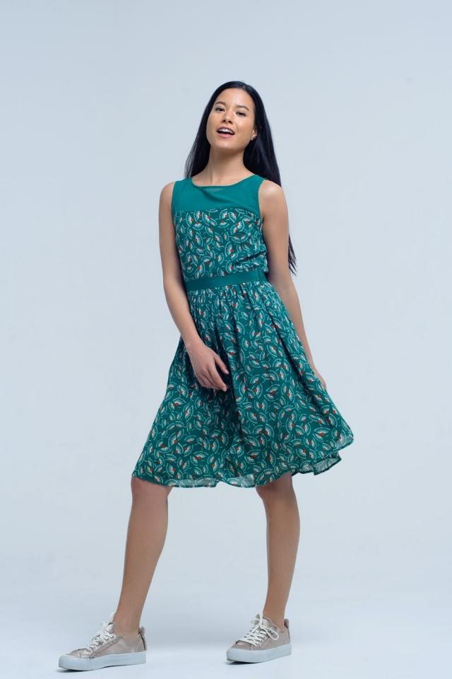 Mini abito verde con stampa geo e fiocco