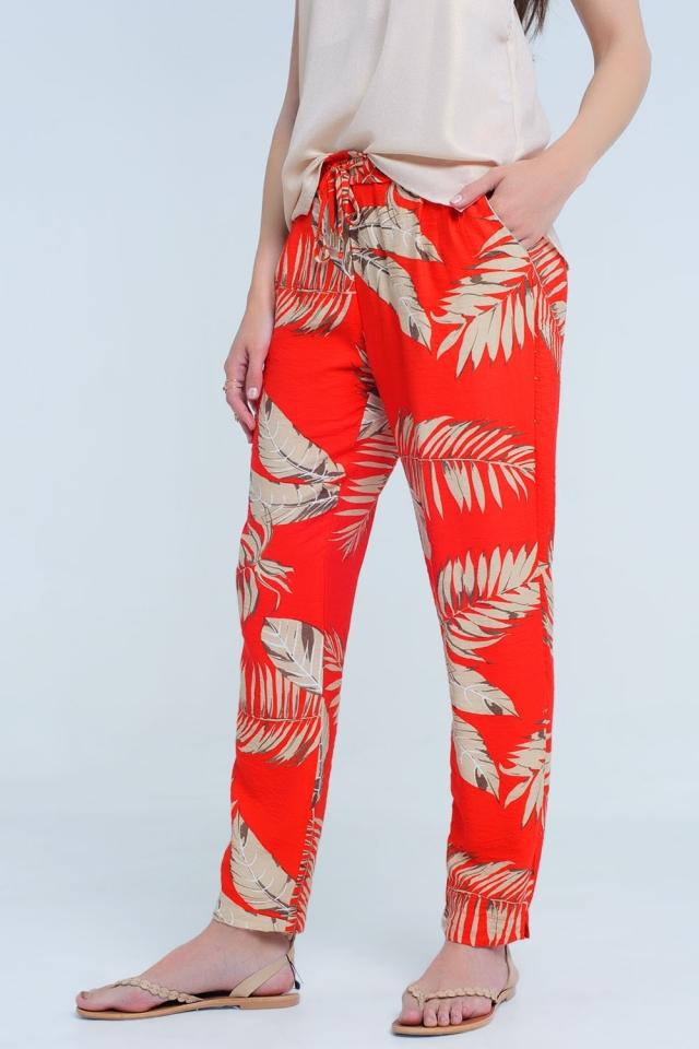 Pantaloni rossi con stampa foglia