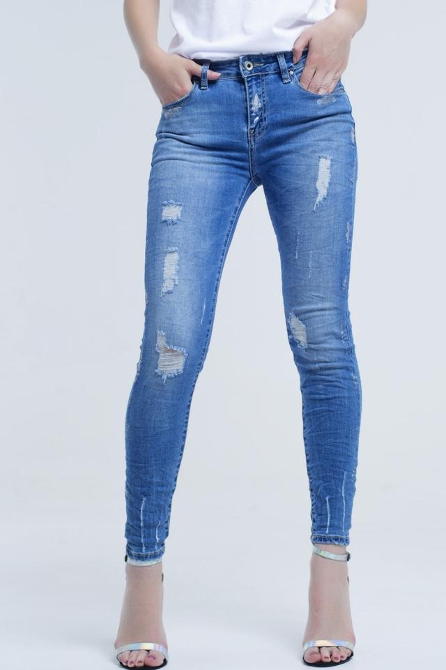 Jeans skinny con strappi e glitter