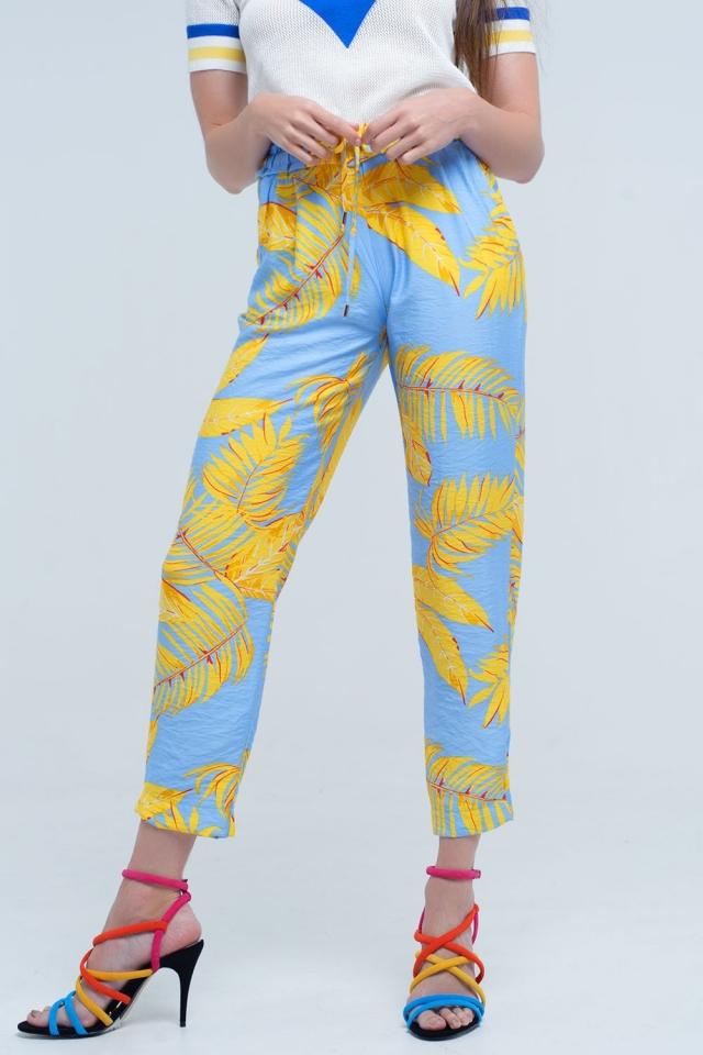 Pantaloni gialli con stampa foglia e tasche