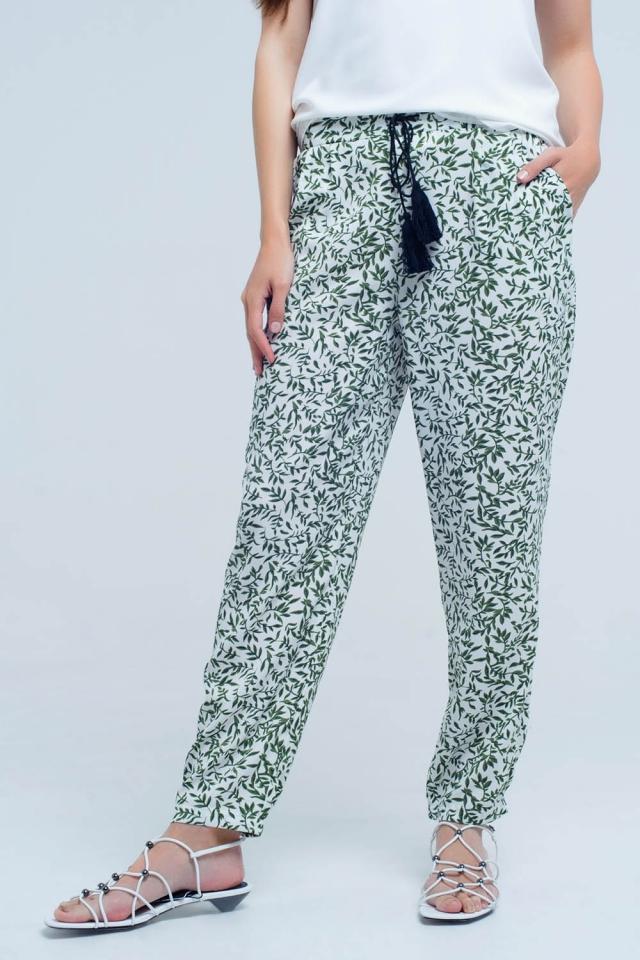 Pantaloni verdi con fogli e tasche stampate