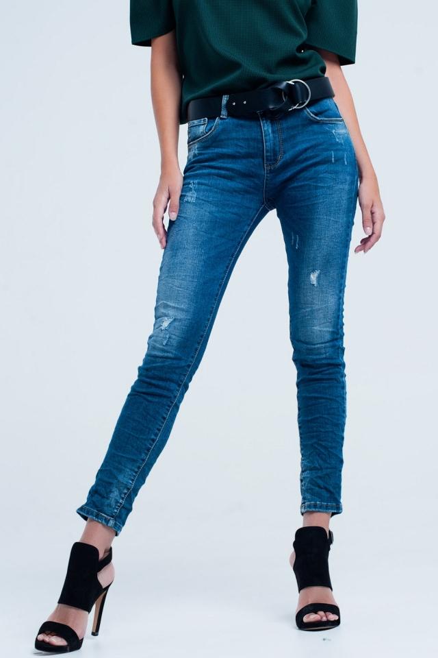 Jeans skinny blu con strappi