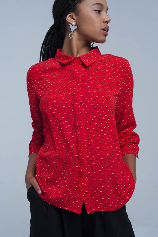 Camicia rossa con pois blu
