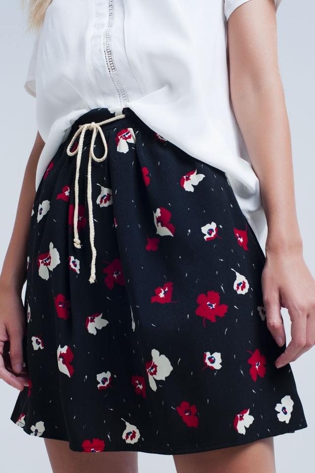 Minigonna nera con motivo floreale