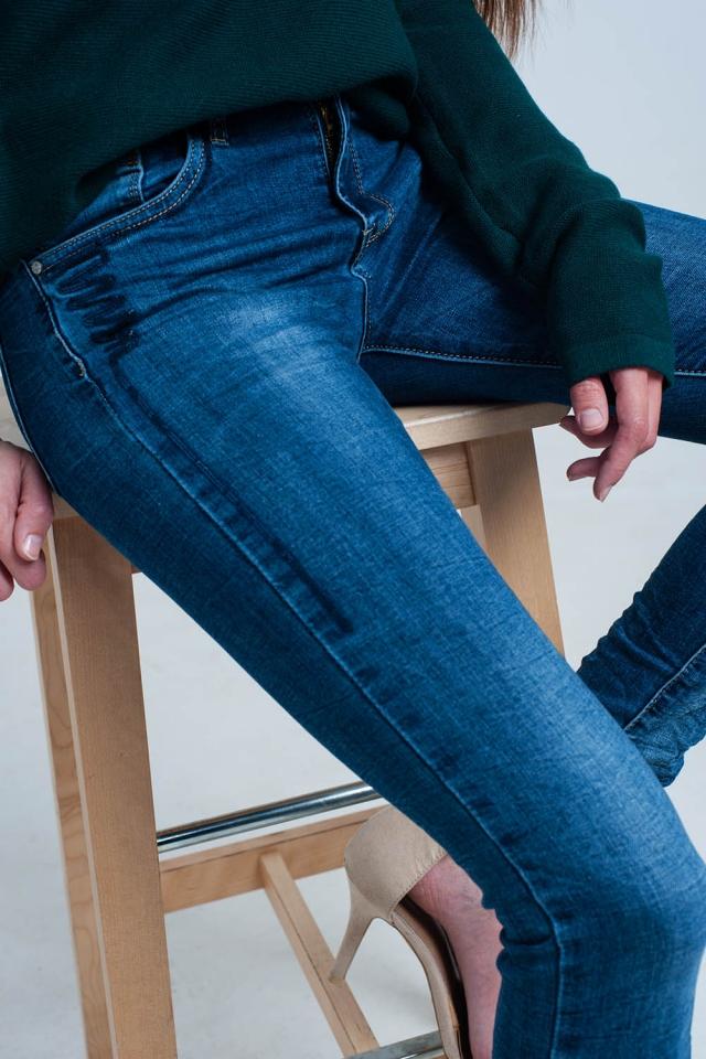 Jeans stropicciati con paillettes