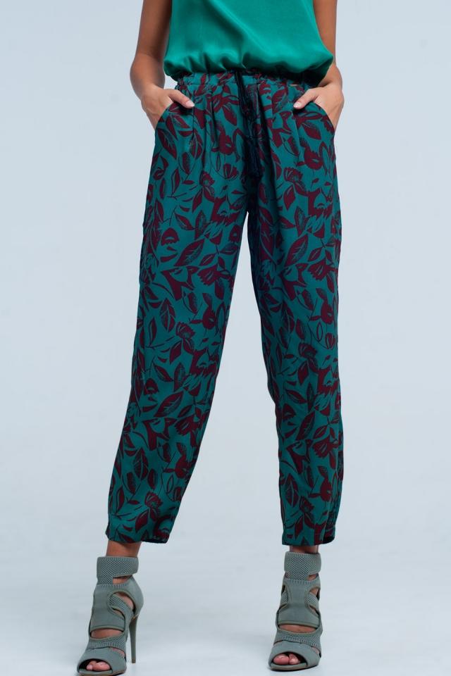 Pantaloni con fondo ampio a fiori verde