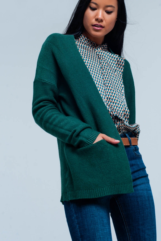 Cardigan verde con tasche