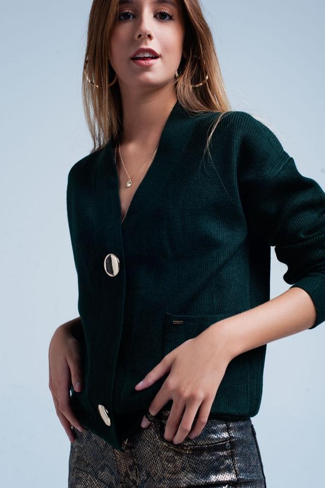 Cardigan in maglia verde scuro con bottoni dorati