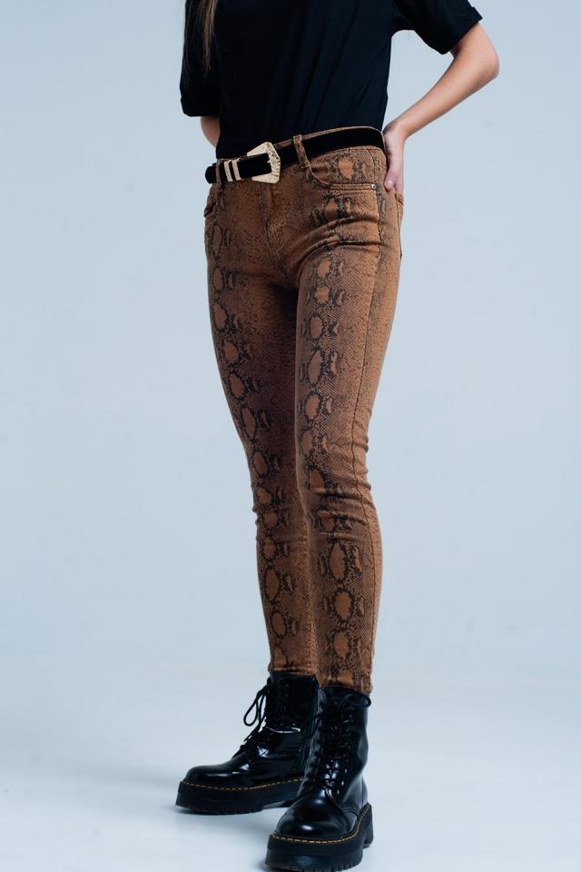 Pantalone skinny arancione in stampa serpente