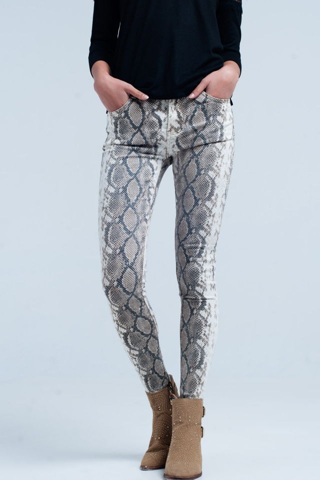 Pantaloni skinny beige con stampa a serpente