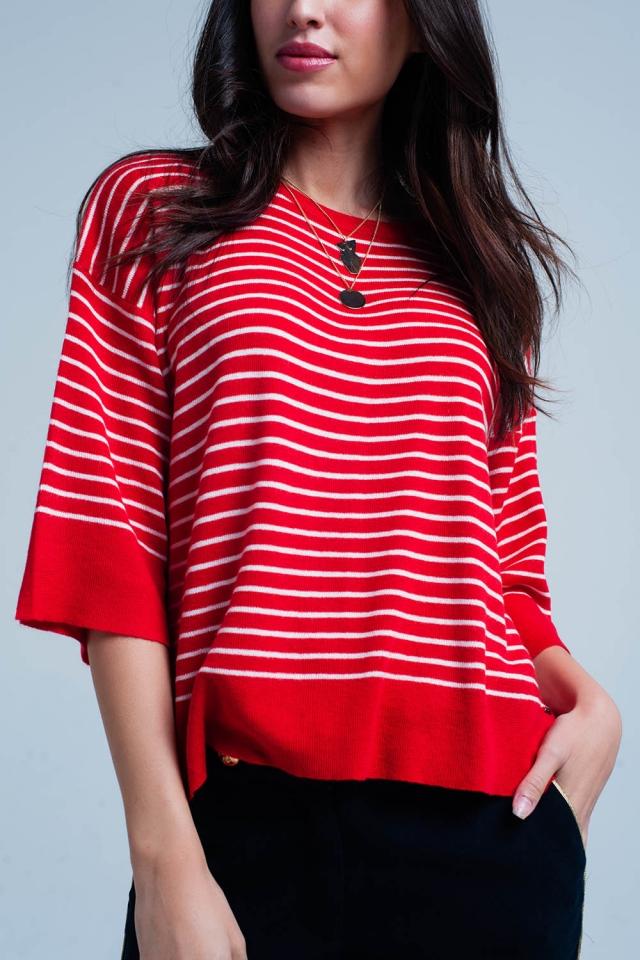 Maglione rosso oversize a righe