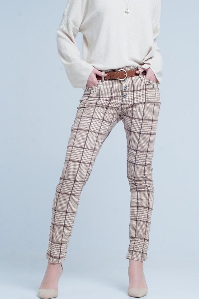 Pantaloni a quadri beige con pulsante