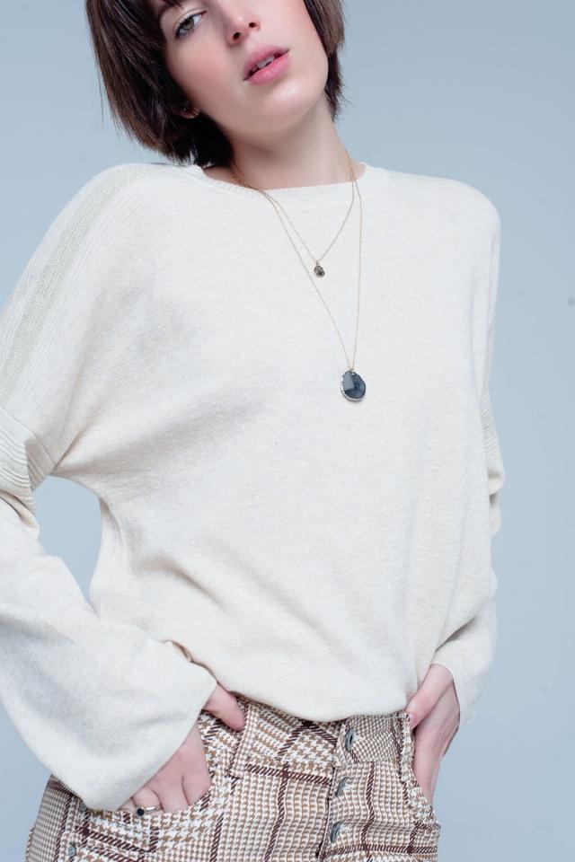 Maglione lavorato a maglia beige con dettagli glitterati