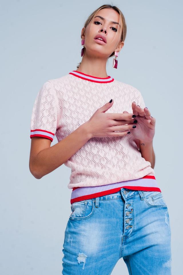 Maglione traforato rosa con motivo geometrico