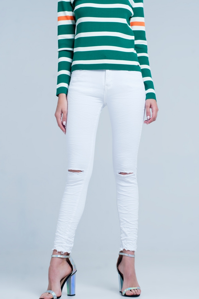 Jeans skinny bianchi con strappi sulle ginocchia