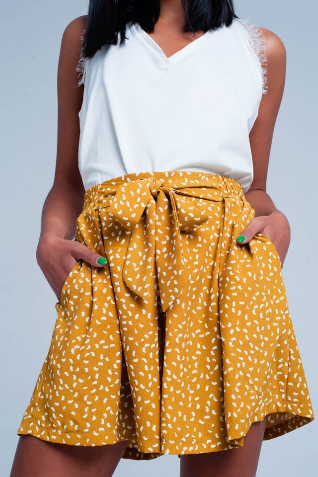 Mustard shorts with flower print