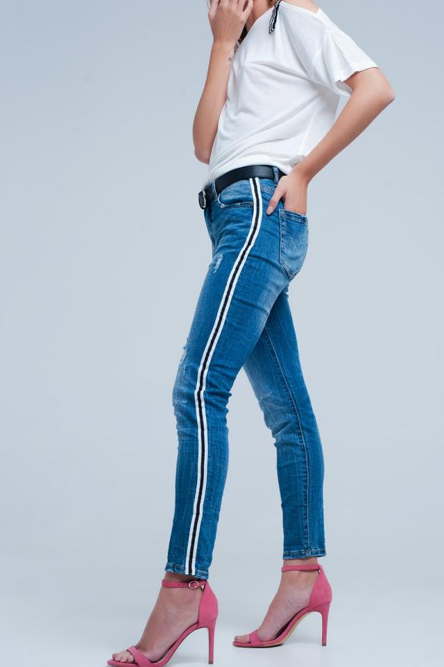 Jeans skinny elasticizzati lavaggio chiaro con strappi e riga laterale