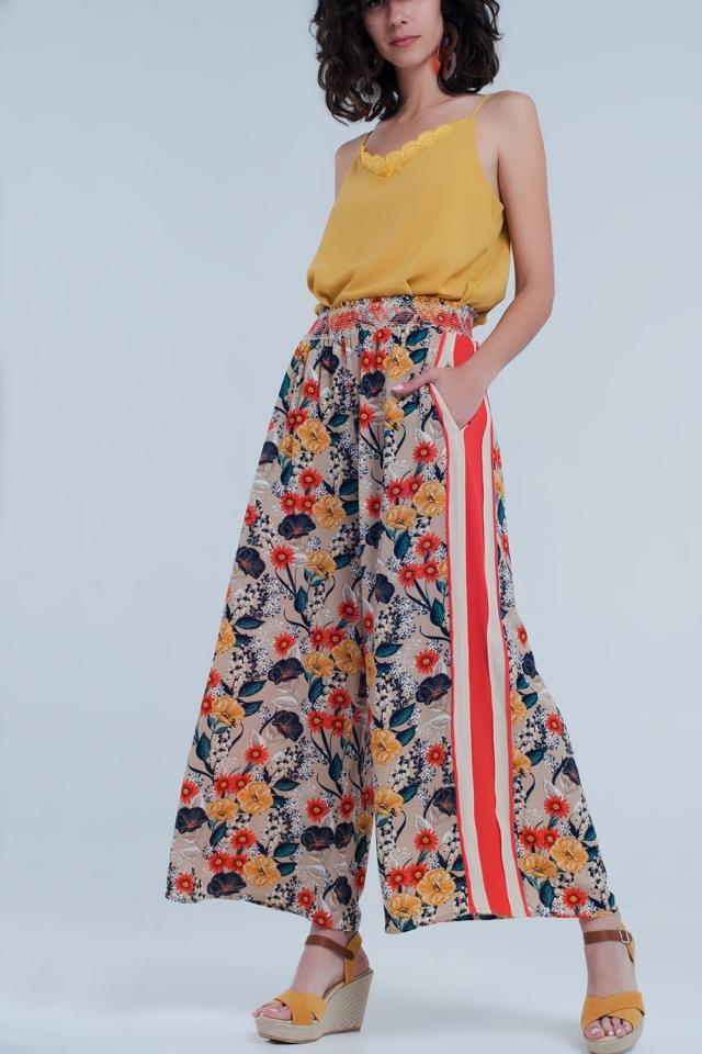 Pantaloni beige con riga laterale a fiori
