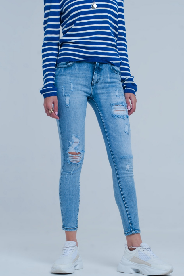 Jeans slim lavaggio chiaro vintage blu con vistosi strappi