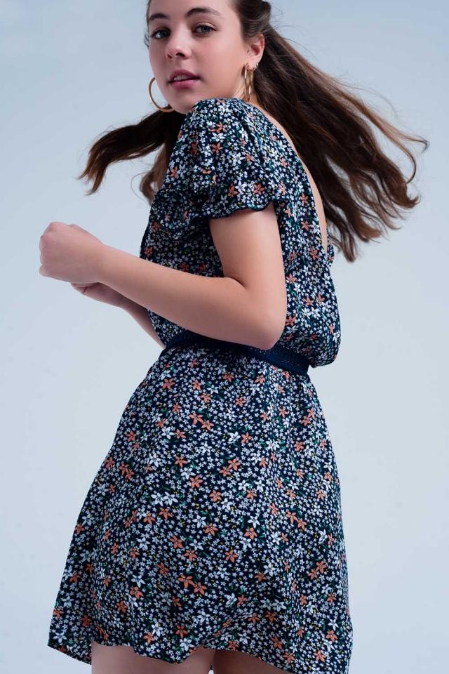 Vestito blu intenso da giorno a fiori con apertura sul retro