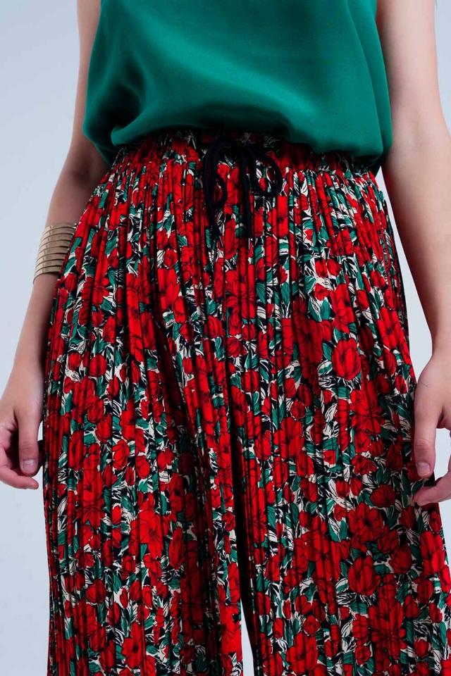 Pantalone a pieghe rosse con stampa floreale