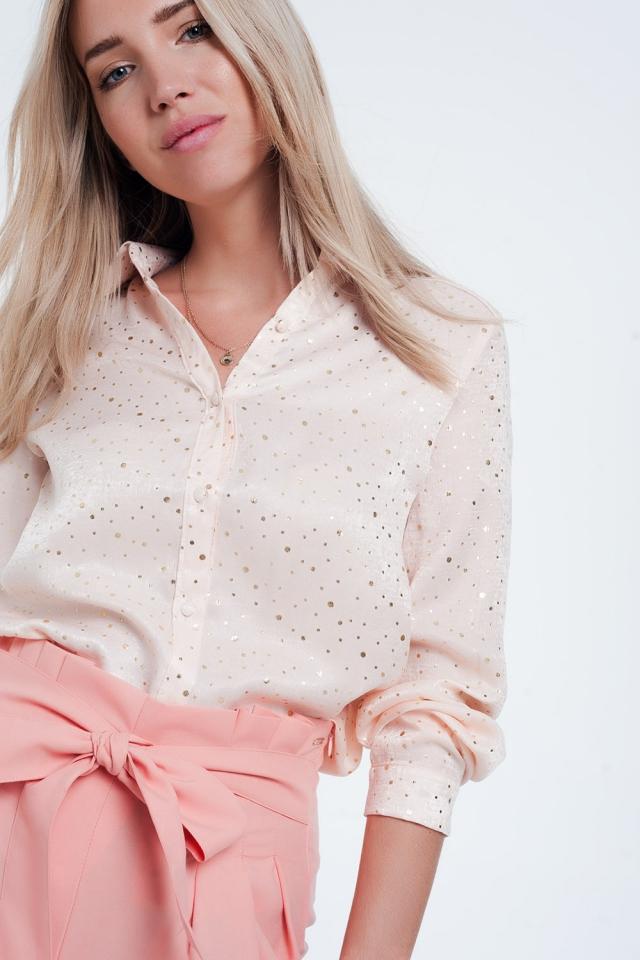 Blusa rosa con maniche lunghe a pois oro