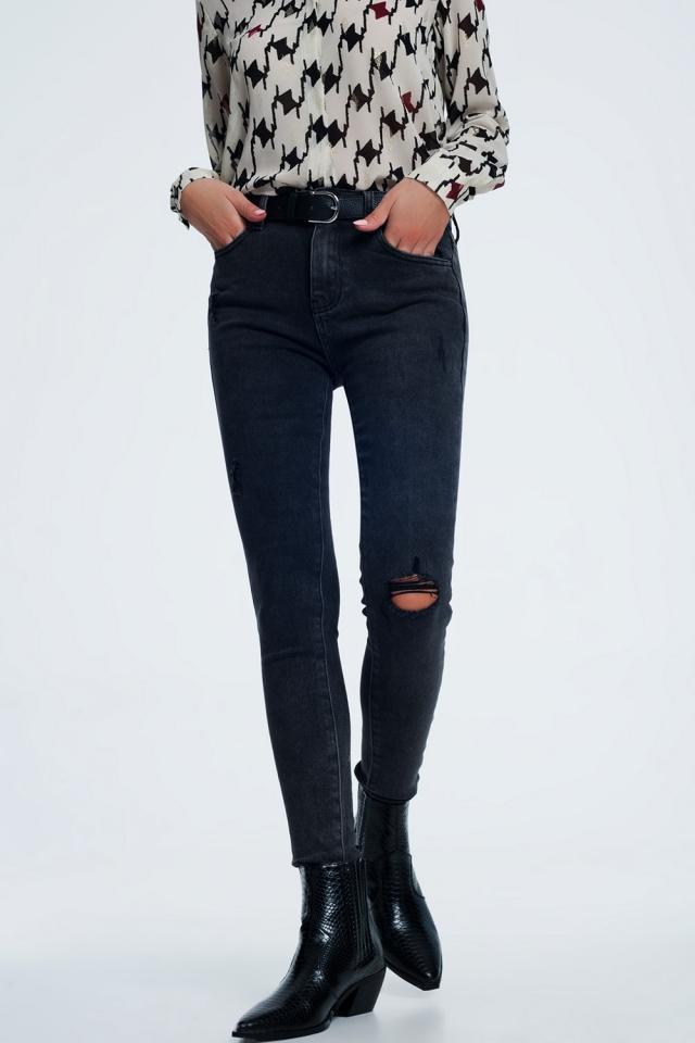 Jeans super skinny nero slavato con abrasioni