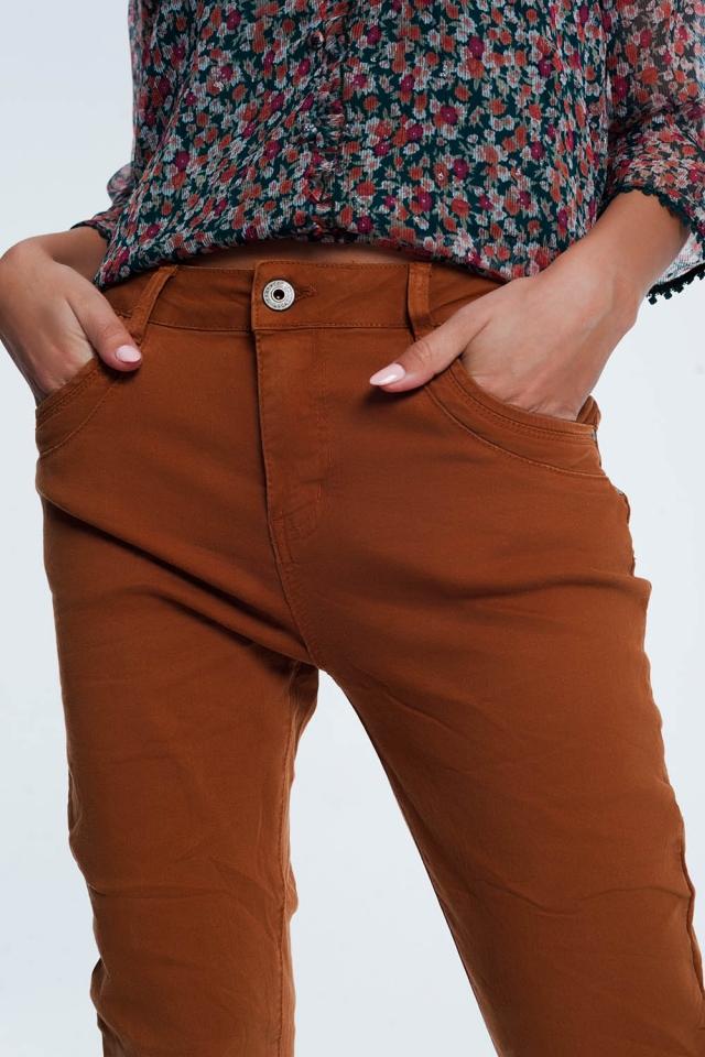 Jeans skinny arancione con cavallo basso