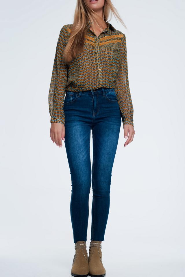 Jeans slim con fondo sfrangiato