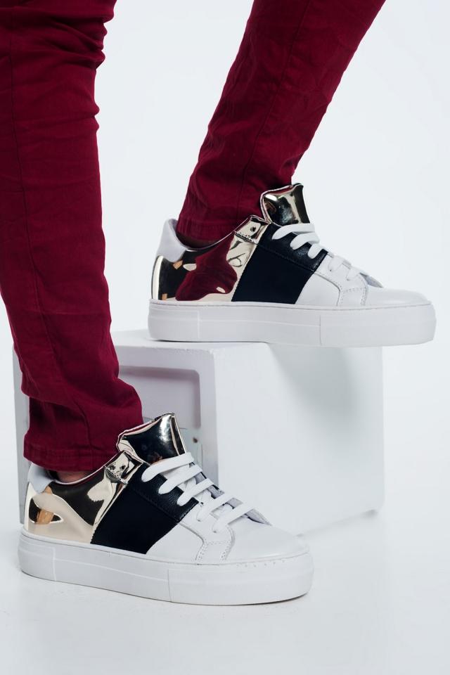 Sneakers nere e oro con suola spessa