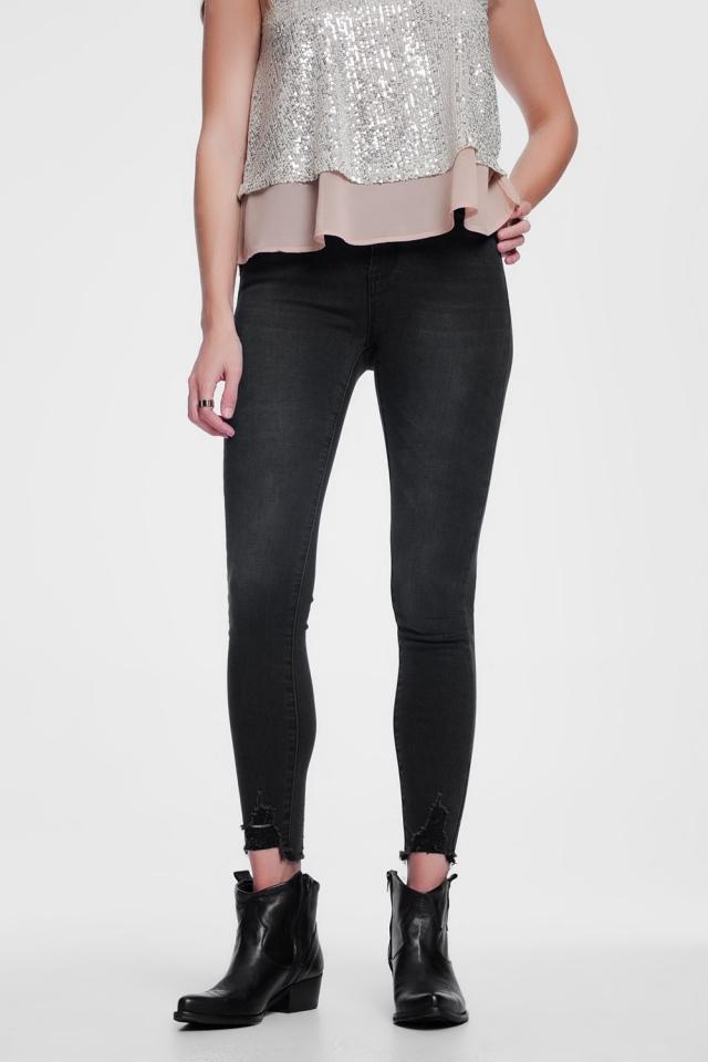 Jeans skinny con fondo grezzo neri