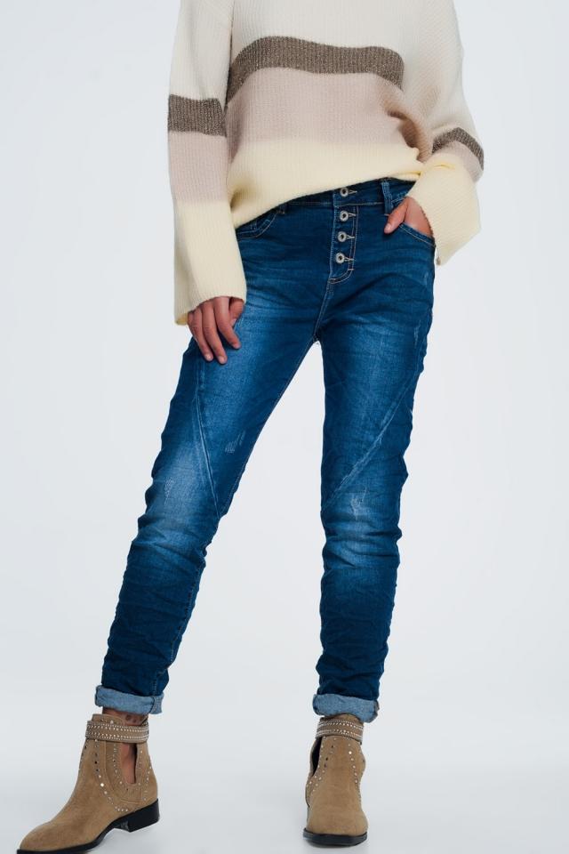 Jeans in blu sbiadito con chiusura a bottoni a vista