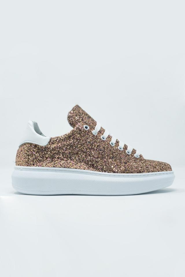Sneakers stringate dorate con glitter e suola spessa