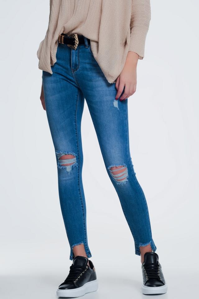 Jeans super skinny con fondo strappato lavaggio chiaro