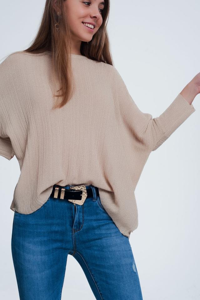 Maglione a maglia fine realizzato con filo metallico beige