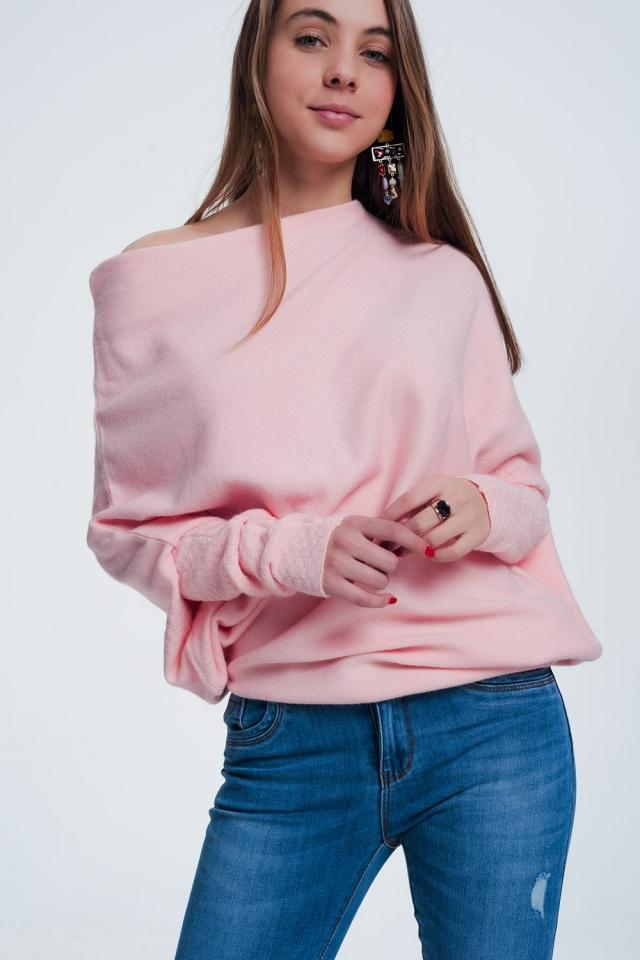 Maglione rosa asimmetrico