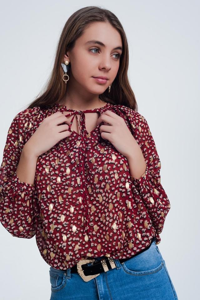 Blusa rosso a pois puntinati oro con fiocco