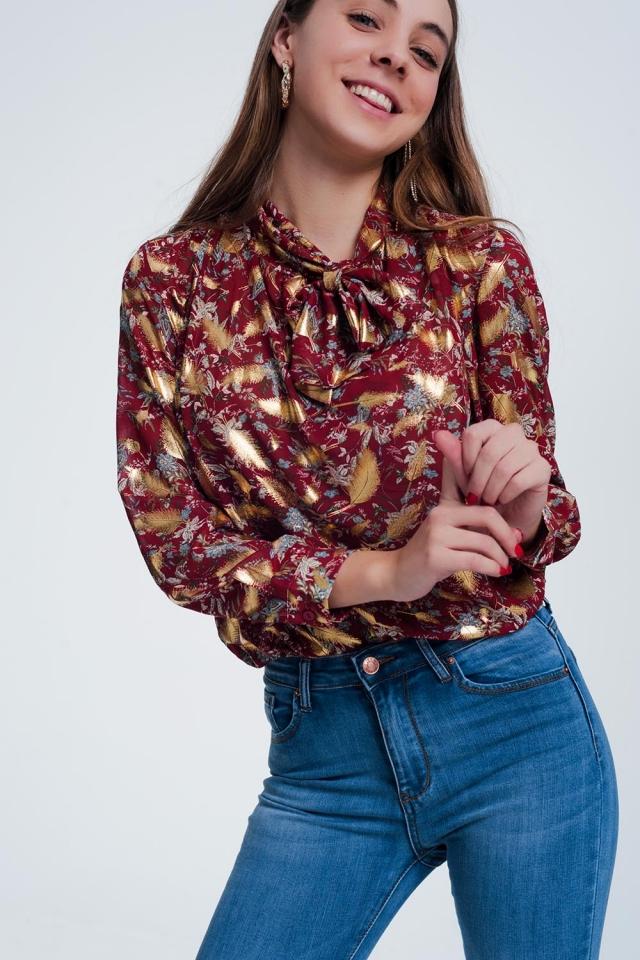 Blusa rossa con stampa a fiori e fiocco morbido