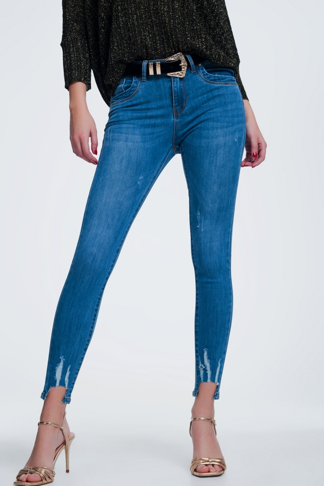 jeans vita alta slim lavaggio chiaro con strappi e fondo grezzo